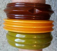 Brown, ivory and olive green vintage bakelite bracelets with carved ridge designs.