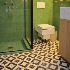 Square green tiles + cement black and white floor tile.