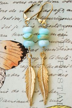 Peruvian opal feather earrings. Tiedupmemories by tiedupmemories