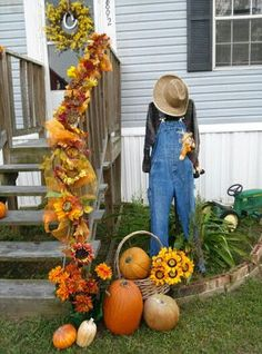 Pumpkins, fall garland and a scarecrow