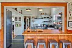 A more open layout gives a Seattle kitchen much-needed breathing room, while classic materials maintain its character