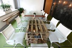 Pallet supports on a cool conference room table.  By Robin Souter of The BIO Agency for their home office in London.