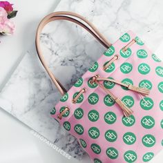 """🎉 DOONEY & BOURKE Exclusive Tote dooney & bourke exclusive tassel tote  ⠀† signature pink & green cotton fabric w/ ⠀genuine leather trim ⠀† gold tone hardware ⠀† interior multifunction pockets (4 slip pockets) ⠀† magnetic snap closure ⠀† fabric lining ⠀† handles with 8.5"""" drop ⠀† 15"""" l x 11.5"""" h x 5"""" w ⠀† made in 🇺🇸 ⠀† new with tags  host pick!   ⠀12.28.15 › best in bags ⠀5.16.16 › work week chic ⠀7.23.16 › best in bags ⠀8.4.16 › wardrobe goals   ⠀9.5.16 › best in bags  ⠀12.10.16 › best…"""