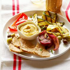 I serve Hummus with fresh veggies instead of pita bread: organic baby carrots, radishes, celery, Persian cucumbers and my favorite, sweet mini peppers. Gluten free and delicious!! Grilled Vegetable Meze Plate