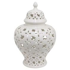 "A timeless addition to your mantel or console table, this lovely ceramic jar showcases a finial top and classic white finish.  Product: Lidded jarConstruction Material: CeramicColor: White  Dimensions: Small: 11"" H x 6.75 "" DiameterLarge: 15.25"" H x 9.5"" Diameter"