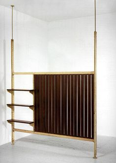JEAN PROUVE' Partition wall with shelves, 1950 Metal & wood Two sizes: From h.249 to 298 x 199 x 23 cm  From h.98.03 to 117.32 x 78.35 x 9.06 inches From h.289 to 361 x 256 x 23 cm  From h.113.78 to 142.13 x 100.79 x 9.06 inches Air France Congo building, Brazzaville, Africa.