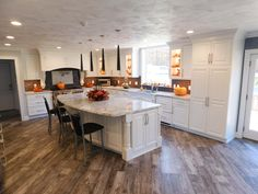 Ford's Pond Residence Kitchen // Reclaimed Wood Look Tile Floor // Arley Wholesale