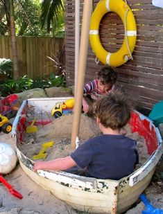 Top Boat Theme Decor Ideas - This boat sand box is such a GREAT idea!