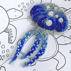 Nautical blue Jellyfish figural brooch ocean jewelry sea creature beaded ******************** Bead embroidered Jelly fish brooch - ocean creature jewelry inspired by summer, ocean, vacation and beautiful beaches. Unique designers jewelry is a beautiful wedding gift, gift for mom, gift for wife, gift for sister - gift women. These make great gifts for those that have everything. The blue sea creature brooch is carefully bead embroidered using Czech beads, Japanese beads, metal chain. * Size…