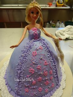Tangled Doll Birthday Cake Decorated in butter cream icing with pearl accents.