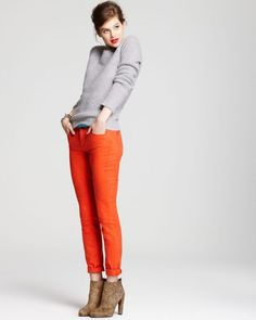 Red jeans, gray sweater, taupe booties.