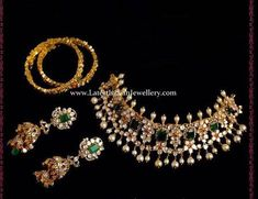 Polki diamond collar necklace in floral design decked with large emeralds. polki diamond double jhumka earrings and bangles from Hiya jewelers