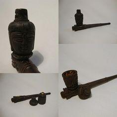 um pipe artesanal, esculpido a mão, com um tampa para o queimador e totalmente em madeira, se liga ai http://www.lojaefeito.com.br/produtos.php?catid=18=49