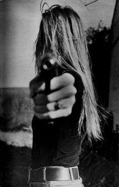 a gun and a girl