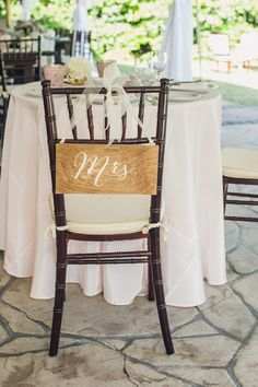 "The bride's Chiavari chair designated with a wooden ""Mrs."" sign {@richardbell}"