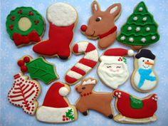 Cookies amanteigados, sabor baunilha ou chocolate, decorados com glacê real feito com produtos industrializados e com corantes alimentícios importados aprovados pelo FDA dos E.U.A. embalados em saquinho celofane, com fita de cetim e tag incluso no preço.  Consulte para embalagem para presente em caixa e para outros modelos e tamanhos de cookies no tema.  Passe em Políticas da Loja para outras informações.  Os cookies são finalizados em 3 cores  do tema Natal Tradicional, em 12 modelos à sua…
