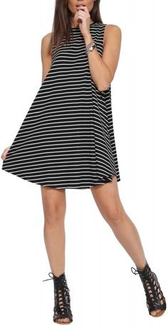 Black/white striped sleeveless dress. Style game on point.