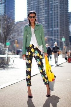 Printed pants worn with a sage leather jacket and white tee