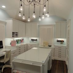 An entire craft room with built-in storage with wall cabinets and flat file drawers. Freestanding island allows easy acces to large workspace from any side.