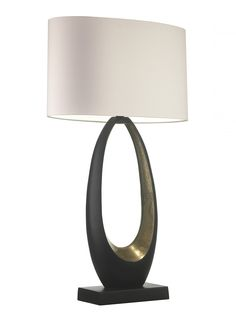 Obus Table Lamp   This simple yet stunning Oval shaped lamp is made from cast aluminium and finished in a semi matt black patina with a beautiful distressed gilt finish to the inside of the curve.