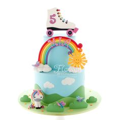 Rainbows, roller skates and unicorns with butterflies and a happy sun to brighten your day! What more could a little girl ask for on her 5th birthday cake! Bright and cheerful this cake just makes me happy looking at it!
