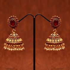 Anvi's ruby jhumkas studded with white stones and pearls Ear Jewelry, Bridal Jewelry, Gold Jewelry, Women Jewelry, Stone Gold, White Stone, South Indian Jewellery, Indian Jewelry, Bridal Hair Plaits