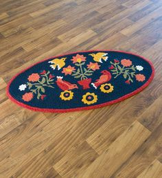 Indoor/Outdoor Ansley Folk Art Rug | A charming addition to any space, our Indoor/Outdoor Ansley Folk Art Rug is the perfect way to bring folk art style home. With a non-skid back that keeps it in its place, this little rug features a textured weave that resembles crochet and beautifully shows off the bird and floral design.