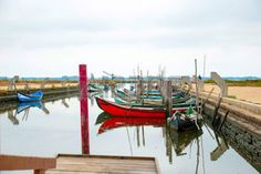 Old boats in water canal of Rio Aveiro, Portugal photo