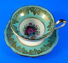 Light Blue and Gold Grape Border with Floral Center Foley Tea Cup and Saucer Set
