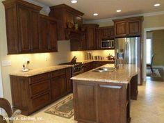 Kitchen with island in The Saint Clair, plan 284. http://www.dongardner.com/plan_details.aspx?pid=224. #Kitchen #Island #Design