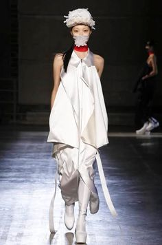 "Designer Masha Ma features high-fashion pollution masks as ""Airpocalypse"" hits China. Ma's very modern fashions are elegant edgy, sophisticated and subversive."