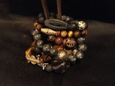 For the Natural Man- Eye of the tiger, African lost wax, pyrite, volcano, African Bone, hematite and antique metals make up these stretch bracelets design with the man in mind.