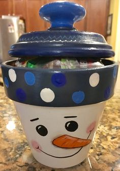 Snowman painted clay pot with clay saucer lid and glued wooden knob.....candy dish