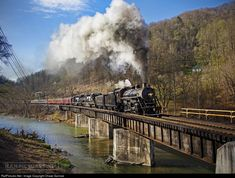 Steam returns to the Buchanan Branch... For the first time in over 55 years, steam returns to the N&W Buchanan Branch on the head end of an NS and TVRM sponsored public excursion. Enroute to Devon, W.Va. from Grundy, Southern 2-8-0 No. 630 crosses Levisa Fork of the Big Sandy River on its 25 mile run to Ought One from downtown Grundy. The public excursions operated a total 71-mile excursion through rural southwestern Virginia, eastern Kentucky, and the southern edge of West Virginia....