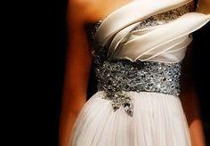 Exquisite and uniquely structured dress.