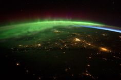 Aurora borealis from space curving over the pacific northwest!!!!!!