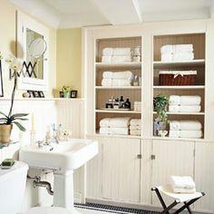 pretty built in storage areas for master bath