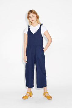 In 100% cotton, this funkadelic denim-y onesie is a total charmer with its sweet ties at the shoulders.