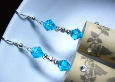 Georgia Sky :: Handcrafted synthetic wine cork earrings featuring clear Swarovski Elements rhinestones, aqua blue bicone crystals, and silver finish etched spacer beads.