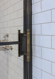 THE FRANKFORD SHOWER DOOR Inspired by vintage factory windows and our Frankford Panel System, we fabricated and installed this custom shower enclosure with operable transom and custom machined bronze door p Bad Inspiration, Bathroom Inspiration, Bathroom Renos, Small Bathroom, Bathroom Renovations, White Bathrooms, Bathroom Images, Brown Bathroom, Luxury Bathrooms