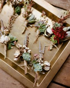Groomsmen boutonnieres made of cotton blooms, succulents, and lavender.