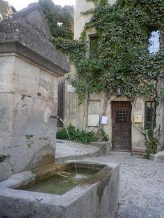 Vine-covered walls. Via Velvet & Linen.