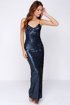 This elegant maxi goes above and beyond your average cocktail dress with a sea of glimmering navy blue sequins cascading from the triangle b...