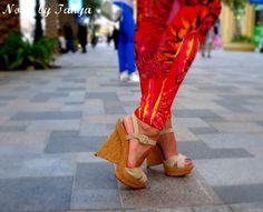Christian Louboutin Sculptured cork wedges in nude color. Paired with Versace H tropical jeans