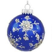 Hand-painted snowflake on blue glass globe ornament