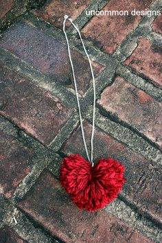DIY Pom Pom Heart Necklace... a cute and easy Valentine's craft