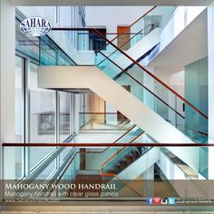 Handrail system installation, clear segmented glass concealed in mahogany handrail.