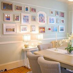 Love how classy this gallery wall filled with Disney memories is!Disney decor I decorating I home I disney home