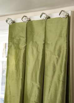 Updated elegance! Reverse box pleat fixed   dress curtains on crystal knobs