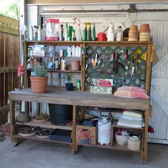 DIY potting bench, hooks, shelves, opens and shuts for potting soil bucket, and it's on wheels!